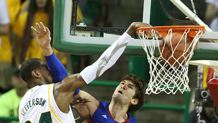 Baylor's Cory Jefferson (34), left, dunks over Kansas Jeff Withey (5) in the first half of an NCAA college basketball game on Saturday, March 9,  2013, in Waco, Texas. (AP Photo/Waco Tribune Herald, Rod Aydelotte)