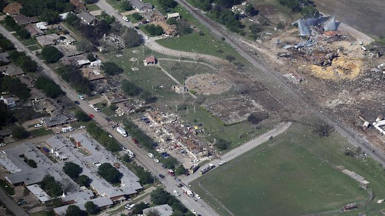 This Thursday, April 18, 2013 aerial photo shows the remains of a nursing home, left, apartment complex, center, and fertilizer plant, right, destroyed by an explosion in West, Texas. Rescuers searched the smoking remnants for survivors of Wednesday night's thunderous fertilizer plant explosion, gingerly checking smashed houses and apartments for anyone still trapped in debris while the community awaited word on the number of dead. Initial reports put the fatalities as high as 15, but later in the day, authorities backed away from any estimate and refused to elaborate. More than 160 people were hurt.  (AP Photo/Tony Gutierrez)