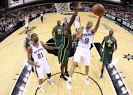 Tony Parker (2nd R) of the San Antonio Spurs takes a shot as Utah Jazz's Paul Millsap during game two of the NBA Western Conference first-round playoff series on May 2. Parker scored 18 points and handed out nine assists for the Spurs