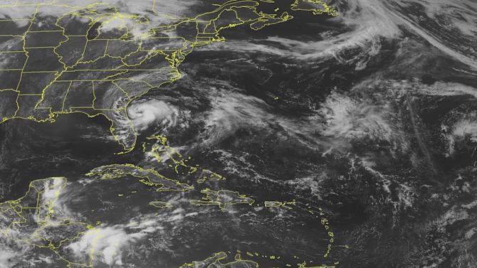 This NOAA satellite image taken Sunday, May 27, 2012 at 01:45 PM EDT shows Tropical Storm Beryl spinning about 110 miles east of Jacksonville, Florida. Beryl is moving toward the west near 10 mph, with sustained winds of 43 mph and gust to 52 mph.  A westward motion is expected to continue through landfall Sunday night.  Tropical storm conditions are expected to reach the coast of northeast Florida and southeastern Georgia this afternoon and continue through tonight.  Dangerous surf conditions, including rip currents and storm surge effect coastal areas of northeastern Florida and Georgia, while rain spreads inland.  For more information on Tropical Storm Beryl, please visit http://www.wunderground.com/tropical.  In the Caribbean, the trough of low pressure associate with Tropical Storm Beryl extends to the northeast Yucatan.  This system produces scattered moderate to isolated strong convection is visible off the east coast of Yucatan and from the coast of Nicaragua to just south of Jamaica.   (AP PHOTO/WEATHER UNDERGROUND)