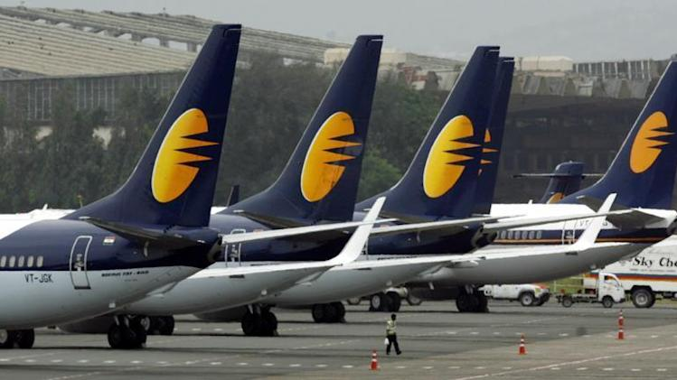 Jet Airways aircraft stand on tarmac at the domestic airport terminal in Mumbai