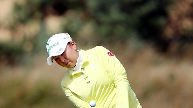 Japan's Miki Saiki chips on to the 17th green during the second round of the Women's British Open golf championship on the Old Course at St Andrews, Scotland, Friday Aug. 2, 2013. (AP Photo/Scott Heppell)
