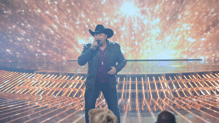 In this Thursday, Dec. 20, 2012 publicity photo released by FOX  X FACTOR season two winner Tate Stevens performs during THE X FACTOR Finale Thursday night Dec. 22, 2012 on FOX. (AP Photo/FOX, Ray Mickshaw)