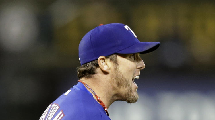 Texas Rangers' Joe Nathan reacts after the final out is made against the Oakland Athletics in the tenth inning of a baseball game Tuesday, May 14, 2013, in Oakland, Calif. (AP Photo/Ben Margot)