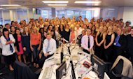 This is a handout photo of News of the World staff in the newsroom in London, as they work on the title's final edition Saturday July 9, 2011. The 168-year-old muckraking tabloid News of the World was shut down Thursday after being engulfed by allegations its journalists paid police for information and hacked into the phone messages of celebrities, young murder victims and even the grieving families of dead soldiers. Its last publication day is Sunday. (AP Photo/Paul Vicente/Sunday Times/Ho) EDITORIAL USE ONLY NO ARCHIVE NOTE TO EDITORS: This handout photo may only be used in for editorial reporting purposes for the contemporaneous illustration of events, things or the people in the image or facts mentioned in the caption. Reuse of the picture may require further permission from the copyright holder.