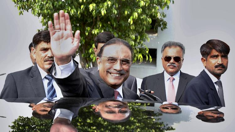 Pakistan's outgoing President Asif Ali Zardari waves as he leaves following a farewell ceremony at President House in Islamabad, Pakistan. Zardari is stepping down Sunday at the end of his five year term, becoming the first democratically elected president in the country's history to complete his full tenure in office. (AP Photo/Anjum Naveed)