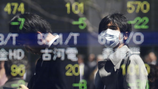 Passersby are reflected in an electric stock price display of a securities firm in Tokyo Thursday, April 4, 2013. Weak economic reports on hiring and service industry growth in the U.S. sent Asian stock markets lower Thursday. (AP Photo/Koji Sasahara)
