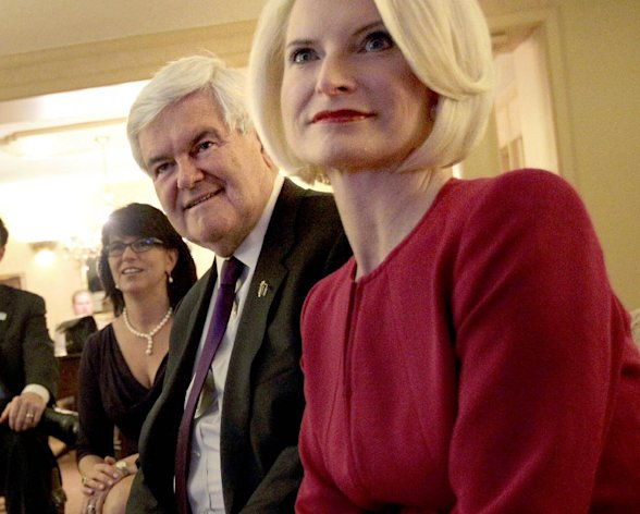 "FILE - In this March 13, 2012 file photo, Jackie Gingrich Cushman, left, sits with her father, Republican presidential candidate, former House Speaker Newt Gingrich and his wife Callista in Birmingham, Ala. Gingrich's daughter says the former House speaker will ""reassess"" his campaign after the votes are tallied in Delaware, potentially setting the stage for his exit from the Republican presidential race. (AP Photo/David Goldman)"