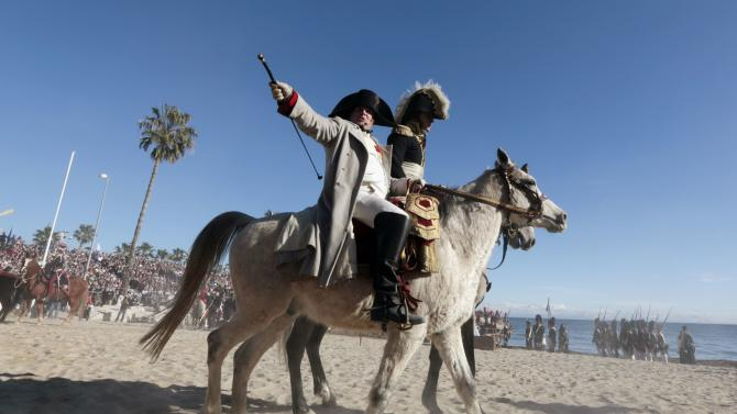 A man dressed as Napoleon rides a horse during the re-enactment of the landing of the Emperor Napoleon Bonaparte in Golfe-Juan as part of the Bicentennial