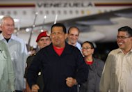 In this photo released by Miraflores Presidential Press Office, Venezuela's President Hugo Chavez arrives at the airport in Maiquetia, Venezuela, Saturday, July 23, 2011. Chavez made an unannounced return to Venezuela on Saturday night after spending a week in Cuba undergoing chemotherapy, saying that he expects a series of additional cancer treatments will take time. (AP Photo/Miraflores Presidential Office)