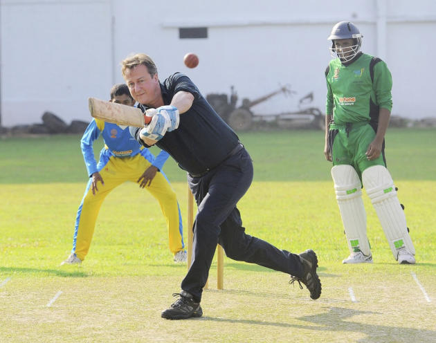 Britain's PM Cameron hits a ball during his visit to the Colombo Cricket Club in Colombo
