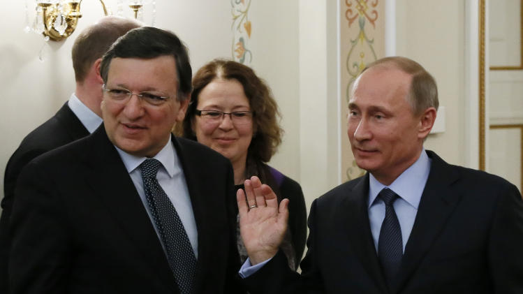 Russian President Vladimir Putin, right, and European Commission President Jose Manuel Barroso meet in the Novo-Ogaryovo residence, outside Moscow, Russia, Thursday, March 21, 2013. The EU and Russia are having one of their biggest spats in recent times over the future of the Cypriot economy. (AP Photo/Yuri Kochetkov, Pool)