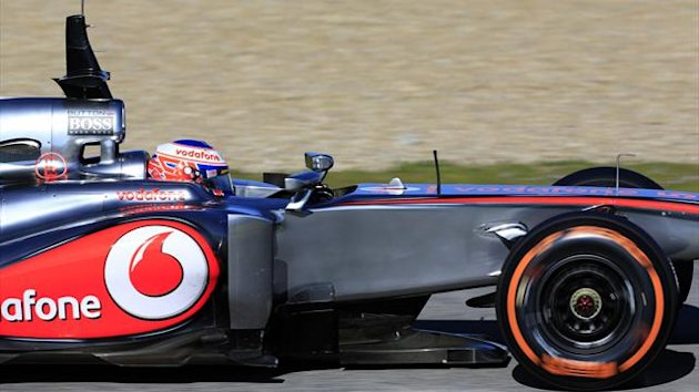Jenson Button tests the McLaren MP4-28 (Reuters)