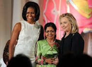 US First Lady Michelle Obama (left) and Secretary of State Hillary Clinton pose with Aneesa Ahmed of Maldives as she receives the 2012 International Women of Courage Award in Washington in March. A Maldives court has ordered the flogging of a girl, 16, who confessed to pre-marital sex in a ruling that Tuesday triggered wide criticism. The UN has said the Maldives must do more to protect women