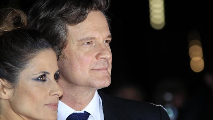 IMAGE DISTRIBUTED FOR RWE - Colin Firth, right, and Livia Giuggioli attending the premiere of Crossfire Hurricane at the Odeon Leicester Square on Thursday, Oct. 18, 2012, in London, UK. (Photo by Joel Ryan/Invision for RWE)