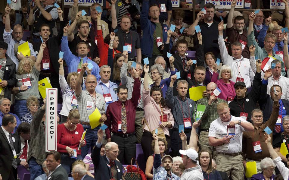 Delegates from Penobscot County vote on a motion during the nomination of national delegates at the Maine Republican Convention at the Augusta Civic Center in Augusta, Maine, Saturday, May 5, 2012. (AP Photo/Robert F. Bukaty)