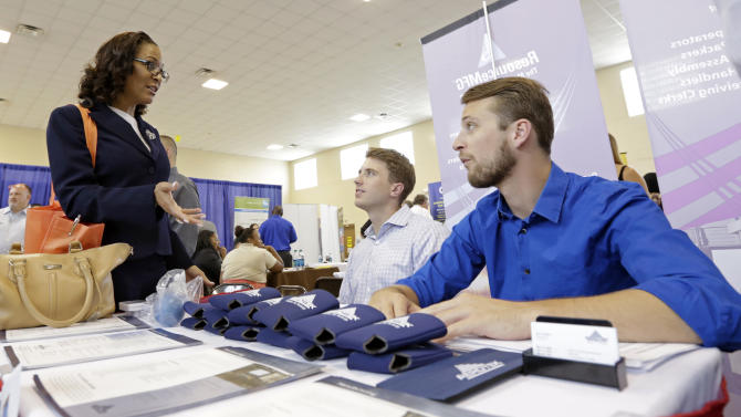 In this photo taken Wednesday, July 16, 2014, job seeker Staci Sudduth, left, talks to job recruiters Cameron Quin, center, and Jay Kington, right, at a Hiring Fair For Veterans in Fort Lauderdale, Fla. Payroll processor ADP reports how many jobs private employers added in July on Wednesday, July 30, 2014. (AP Photo/Alan Diaz)