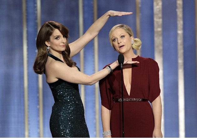 This image released by NBC shows co-hosts Tina Fey, left, and Amy Poehler on stage during the 70th Annual Golden Globe Awards held at the Beverly Hilton Hotel on Sunday, Jan. 13, 2013, in Beverly Hill