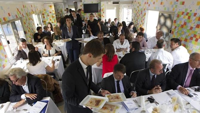 """Customers have a lunch inside a 'Restaumobile' restaurant truck for the start of the operation """"Tous au restaurant"""" in Paris"""