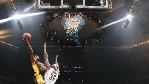 Lakers blow huge lead but beat Nets 99-94