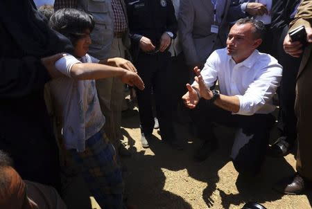 Nickolay Mladenov, the United Nations Secretary-General Special Representative for Iraq, visits a Iraqi refugee camp on the outskirts of Arbil