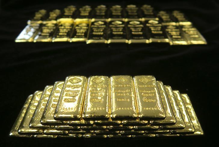 Gold slides to three-month low as dollar soars after Yellen comments
