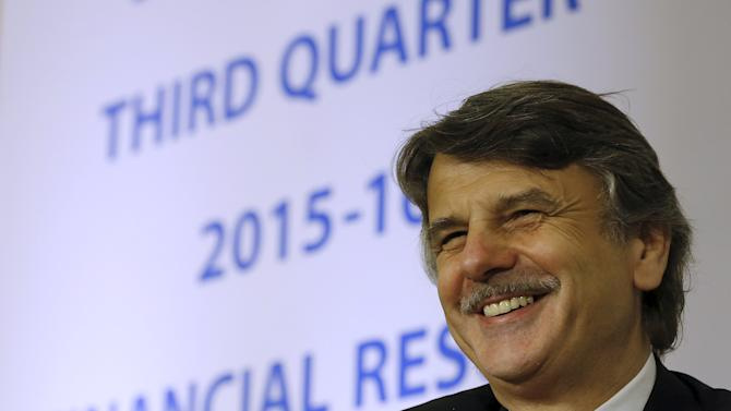 Jaguar Land Rover (JLR) Chief Executive Officer Ralf Speth smiles during a news conference to announce Tata Motors' third quarter results in Mumbai