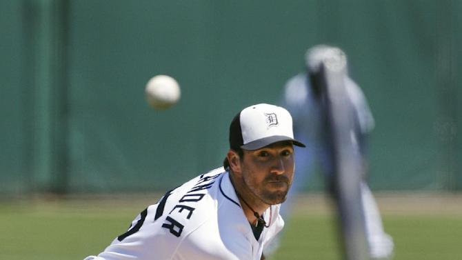 Detroit Tigers starting pitcher Justin Verlander throws during the first inning of an exhibition spring training baseball game against the Philadelphia Phillies, Wednesday, March 27, 2013 in Lakeland, Fla. (AP Photo/Carlos Osorio)