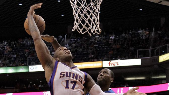 Phoenix Suns' P.J. Tucker (17) has his shot blocked by Dallas Mavericks' Elton Brand during the second half of an NBA basketball game, Thursday, Dec. 6, 2012, in Phoenix. (AP Photo/Matt York)