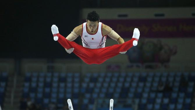 Japan's Yusuke Saito competes in the men's parallel bar event of the team gymnastics competition at the Namdong Gymnasium Club during the 17th Asian Games in Incheon