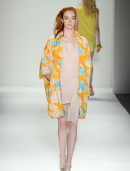 A model walks the runway at the Tracy Reese spring 2013 fashion show for TRESemme during New York fashion week at The Studio at Lincoln Cente in New York City. Reese capitalized on her high-profile sartorial relationship with First Lady Michelle Obama with a sparkling show Sunday that paid homage to every woman's inner nerd