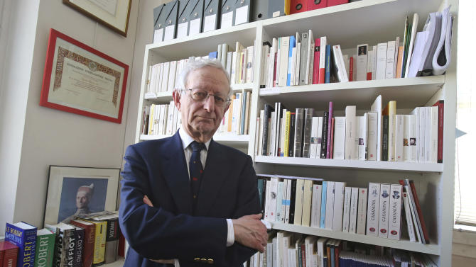 """In this photo taken Tuesday, April 2, 2013, Michael Edwards poses for a photograph during an interview with The Associated-Press at his office at the College de France in Paris. The man who will soon become the newest official guardian of the French language has spoken: English, he says, is jumping the barricades and threatening the language of Moliere. Edwards should know. He's British - the first to become one of the 40 esteemed """"immortals"""" of the Academie Francaise, the institution that has watched over the French language since 1635. (AP Photo/Michel Euler)"""