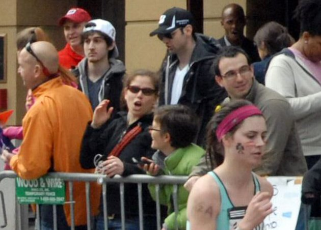 This Monday, April 15, 2013 photo provided by Bob Leonard shows third from left, Tamerlan Tsarnaev, who was dubbed Suspect No. 1 and second from left, Dzhokhar A. Tsarnaev, who was dubbed Suspect No. 2 in the Boston Marathon bombings by law enforcement. This image was taken approximately 10-20 minutes before the blast. (AP Photo/Bob Leonard)
