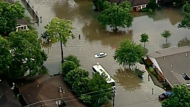 Houston family narrowly survives torrent of water