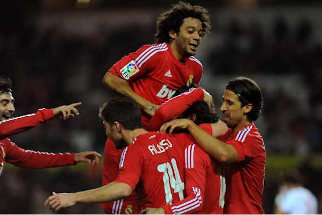 Real Madrid's midfielder Turkish Hamit Altintop (2ndR) celebrates with teammates after scoring during their Spanish league football match Sevilla FC vs Real Madrid on December 17, 2011 at Ramon Sanche