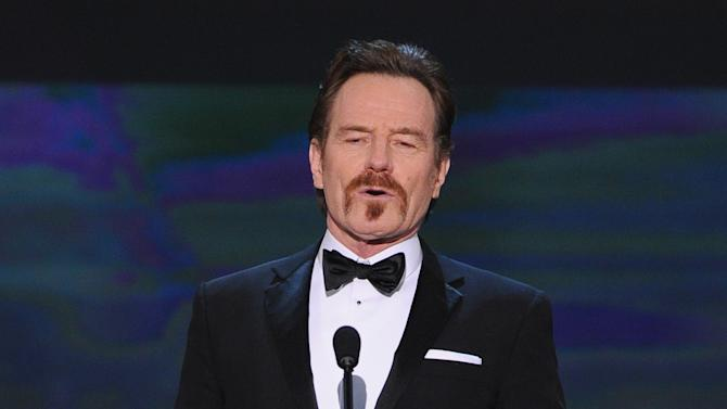 Bryan Cranston speaks on stage at the 21st annual Screen Actors Guild Awards at the Shrine Auditorium on Sunday, Jan. 25, 2015, in Los Angeles. (Photo by Vince Bucci/Invision/AP)