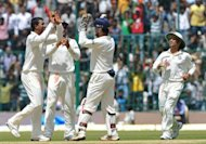 Indian bowler Pragyan Ojha celebrates with his teammates the dismissal of New Zealand captain Ross Taylor during the third day of the second Test match between India and New Zealand at the M. Chinnaswamy Stadium in Bangalore. Indian off-spinner Ravichandran Ashwin bagged five wickets to throw the second and final Test against New Zealand wide open on the third day in Bangalore