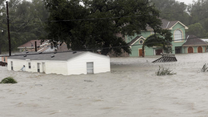 Homes are flooded as Hurricane Isaac hits Wednesday, Aug. 29, 2012, in Braithwaite, La. As Isaac made landfall, it was expected to dump as much as 20 inches of rain in several parts of Louisiana. (AP Photo/David J. Phillip)