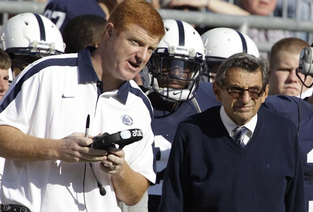 FILE - In this Oct. 8, 2011 file photo, Penn St. assistant football coach Mike McQueary, left, talks with head coach Joe Paterno during an NCAA college football game against Iowa,  in State College, P