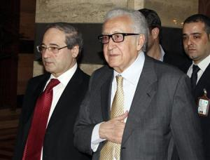 United Nations Envoy Lakhdar Brahimi returns to a hotel after meeting Syria's President Bashar al-Assad in Damascus