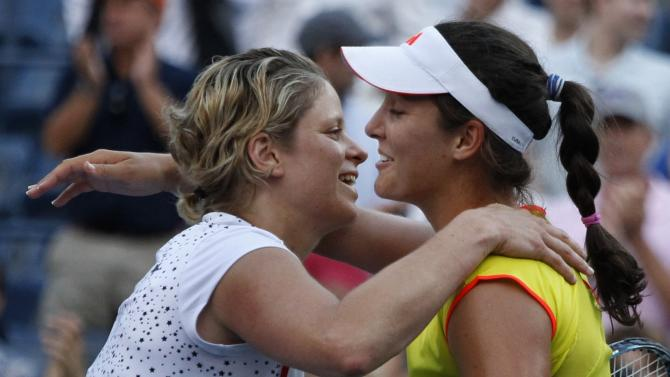 Kim Clijsters of Belgium, left, hugs Laura Robson of Great Britain after Robson won in the second round of play at the 2012 US Open tennis tournament,  Wednesday, Aug. 29, 2012, in New York. (AP Photo/Mel C. Evans)