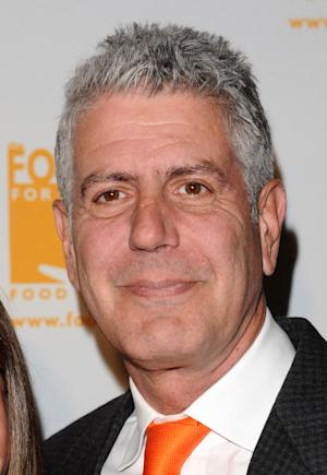FILE - In this April 7, 2011 file photo, Anthony Bourdain attends the Food Banks Can Do Awards gala in New York. CNN announced Tuesday, May 29, 2012, that Bourdain will host a weekend show on food and travel.  The series is expected to launch early next year. (AP Photo/Peter Kramer, file)