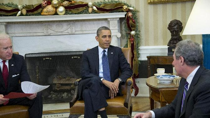 President Barack Obama and Vice President Joe Biden meet with U.S. Trade Representative Michael Froman in the Oval Office of the White House in Washington, Monday, Dec. 16, 2013. (AP Photo/ Evan Vucci)