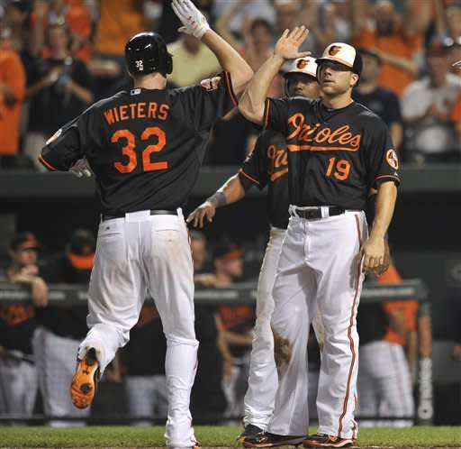 Orioles rally past Indians 9-8
