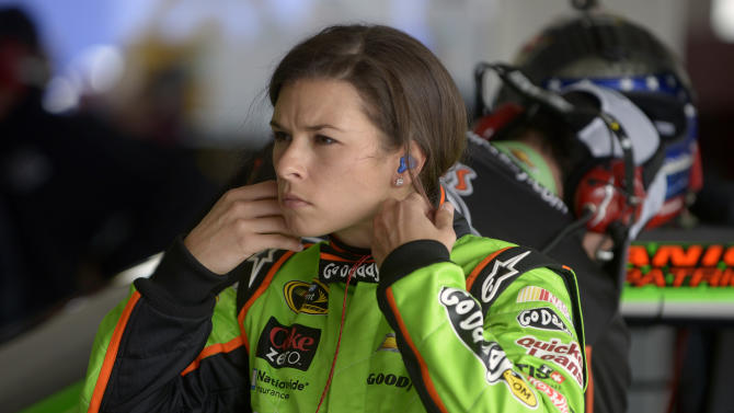 Danica Patrick removes her earplugs after a turn driving during practice for the NASCAR Daytona 500 Sprint Cup Series auto race at Daytona International Speedway, Saturday, Feb. 16, 2013, in Daytona Beach, Fla. (AP Photo/Phelan M. Ebenhack)