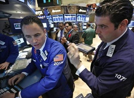 Traders work on the floor at the New York Stock Exchange, April 17, 2013. REUTERS/Brendan McDermid