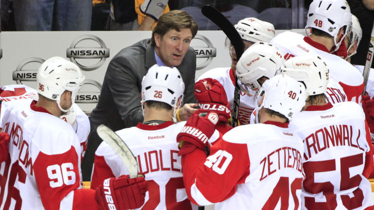 Detroit Red Wings head coach Mike Babcock, top center, talks with his players in the third period of Game 5 against the Nashville Predators in a first-round NHL hockey playoff series on Friday, April 20, 2012, in Nashville, Tenn. The Predators won 2-1 to win the series 4-1. (AP Photo/Mark Humphrey)