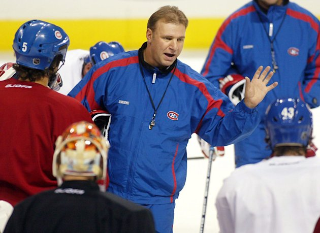 FILE - This Oct. 8, 2002 file photo shows Montreal Canadiens coach Michel Therrien  gesturing during a team practice in Montreal. The Canadiens have hired Therrien as their coach again. He was fired b