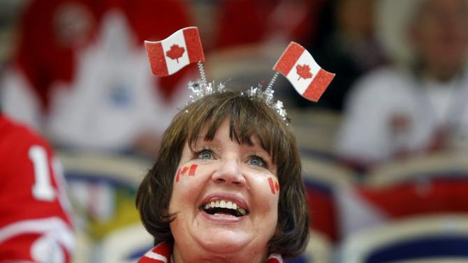 A Canada supporter smiles during a break in play against Germany of their IIHF World Junior Championship ice hockey game in Malmo