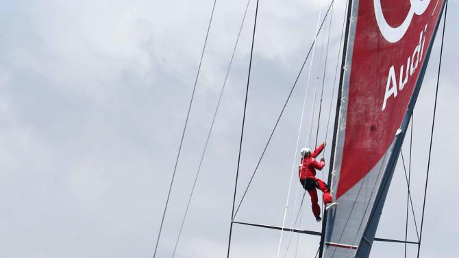 The crew of Wild Oats XI send a crewman up the main sail prior to the start of the Sydney to Hobart Yacht Race